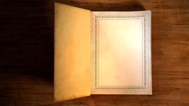vídeos y material grabado en eventos de stock de apertura de libro con páginas de giro de alta definición - libro