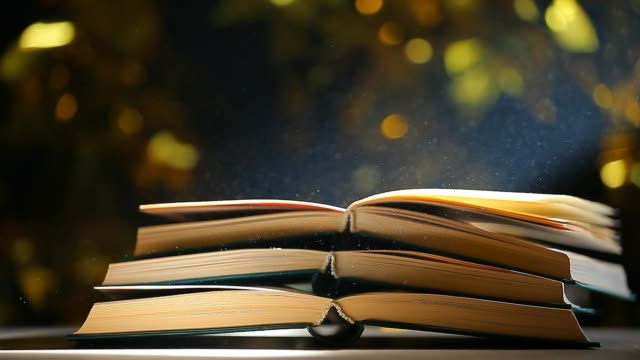 book table dust nobody gold bokeh hd footage
