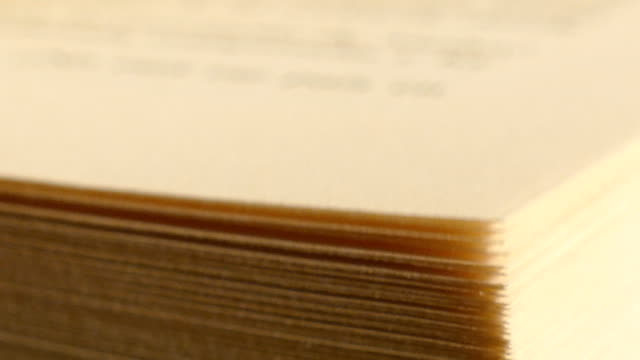 Book with turning pages Extreme close-up of a book pages in turning action page stock videos & royalty-free footage