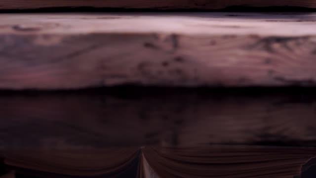 stockvideo's en b-roll-footage met boeken over een oude houten tafel close-up. mooie donkere achtergrond. - heilig geschrift