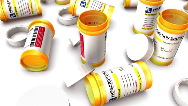 boom down from single empty pill bottle revealing endless bottles - amfetamin pills bildbanksvideor och videomaterial från bakom kulisserna