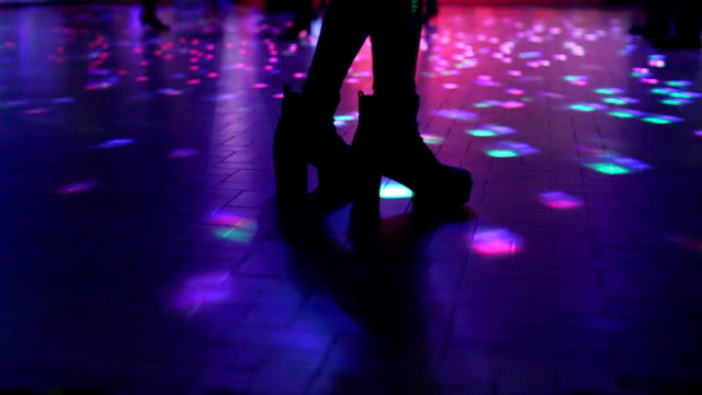 boots dancing in disco video