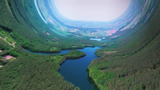 ボーダレスな世界。曲がる湖と森の風景 - シュールレアリズム点の映像素材/bロール