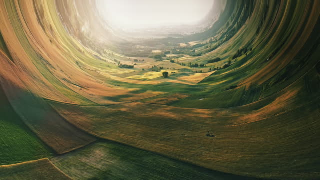 Borderless worlds. Bending rural landscape with fields