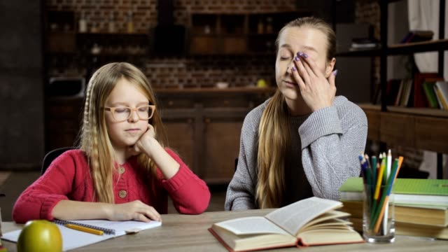 Bored girl unwilling to do homework with mother video