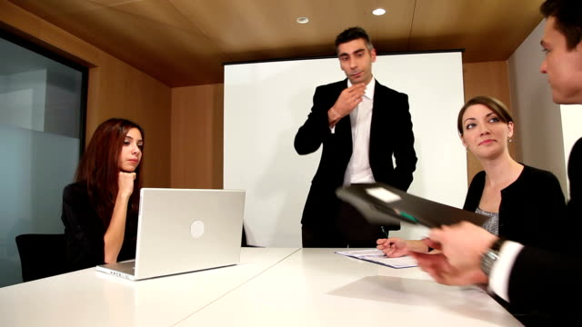 Boss pleased with employee's work in meeting video