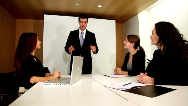 Boss shares good news in business meeting video