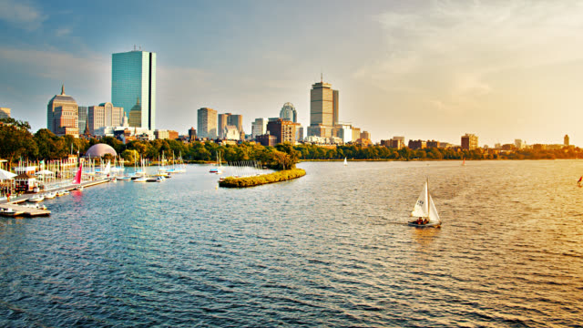 Boston. Skyline. River. Yacht. Sunset.