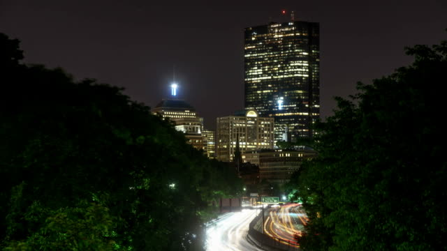 Boston Traffic Timelapse at Night.  Busy City Motion along Storrow Drive, looking at the tall buildings Downtown. video