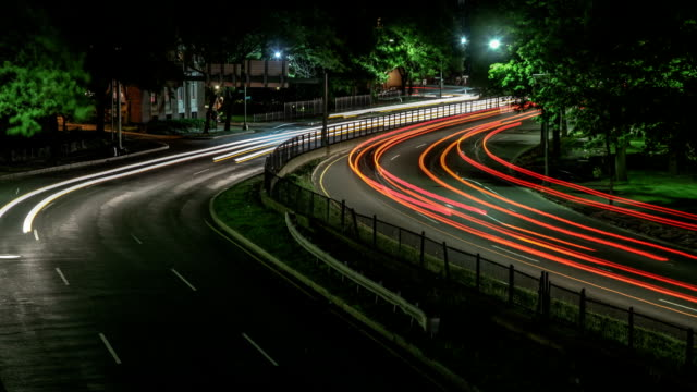 Boston Traffic Timelapse at Night.  Busy City Motion along Storrow Drive, Downtown. video