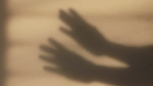 Both hands are showing gestures on the wall. video