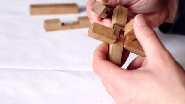 vídeos de stock e filmes b-roll de both hands, wooden sticks, ancient chinese architecture model - quebra cabeças