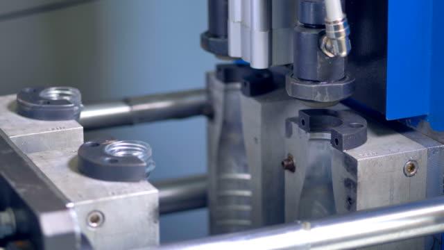 PET Bottle blow-molding process in detailed view. 4K. video