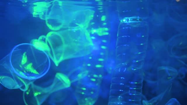 Bottle falling down loop of slow motion in background.Plastic waste in the Pacific ocean.Video 4K Resolutions.