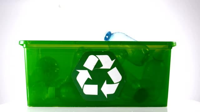 Bottle falling in a green box video