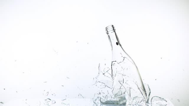 bottle of water breaking a against white background, slow motion 4k - getty filmów i materiałów b-roll