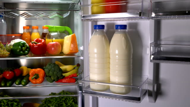 Bottles of milk in the fridge Products in the refrigerator. Bottles of milk in the fridge fridge stock videos & royalty-free footage