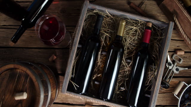 Bottles of wine in a box on the table.