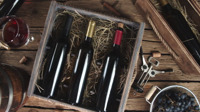 Bottles of wine in a box with straw.