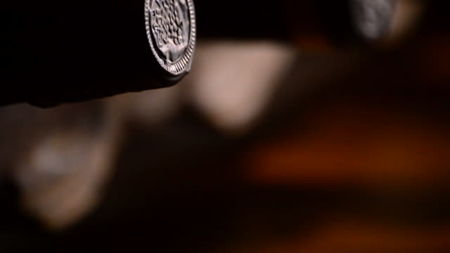 Bottles of wine in a cellar, close up video