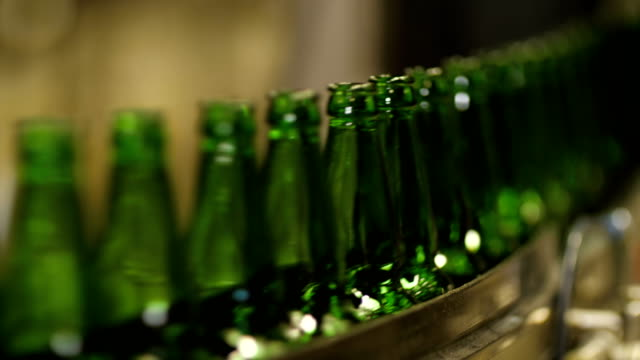Bottles on conveyor belt factory - video