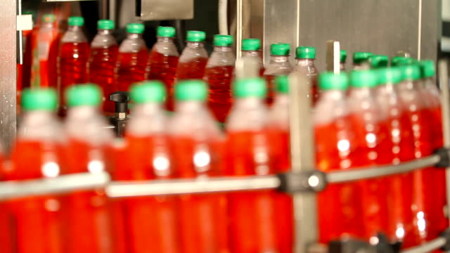 Bottling of juice in plastic bottles video