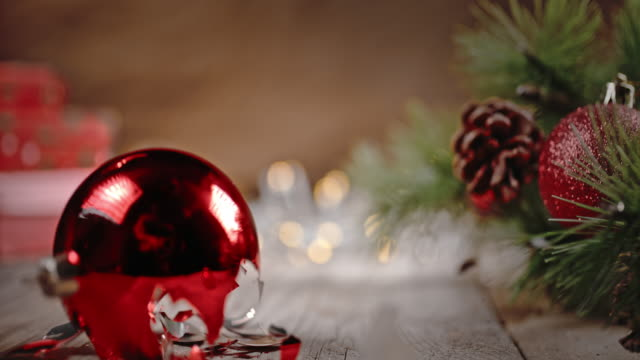 SLO MO Bouncing Christmas ball crushed into pieces Slow motion shot of a red fragile Christmas bauble falling on the floor, first it bounced and secondly it crushed into pieces. decoration stock videos & royalty-free footage