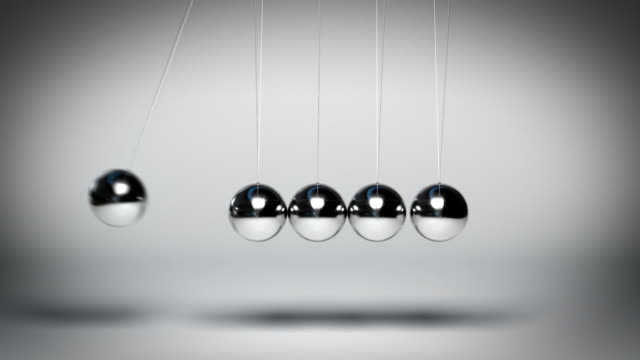 bouncing newton's balls against gray background seamless loop - armonia video stock e b–roll