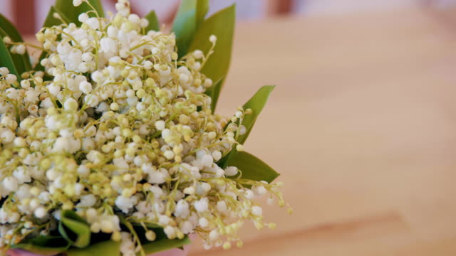 bouquet of lily of the valley on a wooden table video