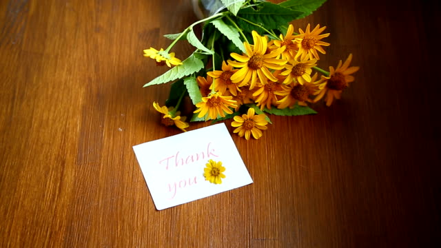 bouquet of yellow big daisies on a wooden