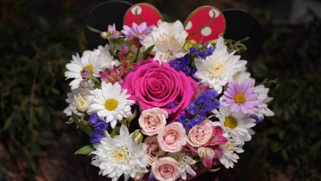 bouquet with fresh flowers on display of floral shop closeup