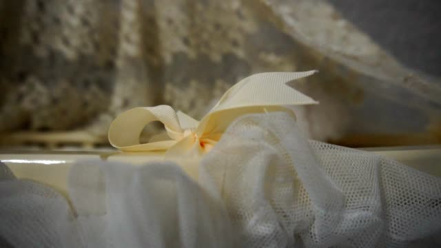 Bow on the baby cot close-up Bow on the baby cot close-up, Full HD tulle netting stock videos & royalty-free footage