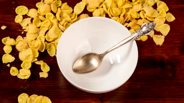 bowl fills cornflakes and milk, stop motion animation video