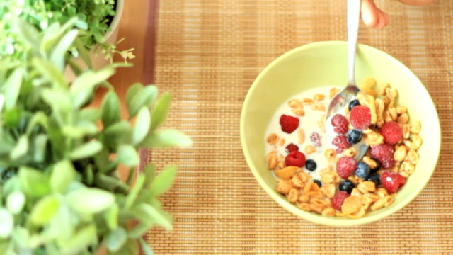 Bowl of breakfast cereal and fresh fruits video