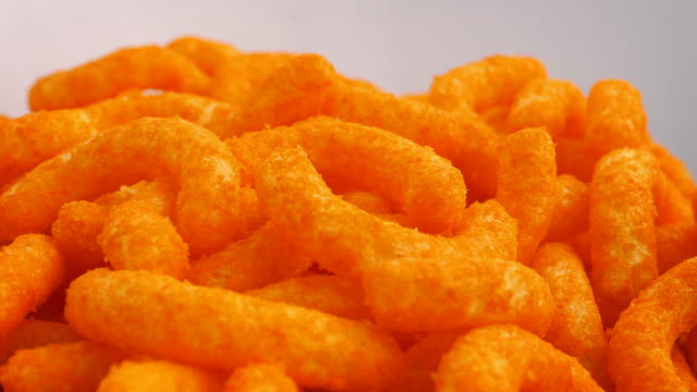 Bowl Of Cheese Puffs Rotating Cheese puffs snack rotating in bowl potato chip stock videos & royalty-free footage