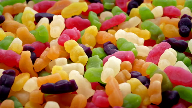 bowl of gummy bears rotating slowly - dolci video stock e b–roll