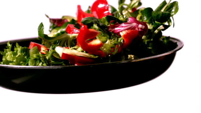 Bowl of salad being tossed video