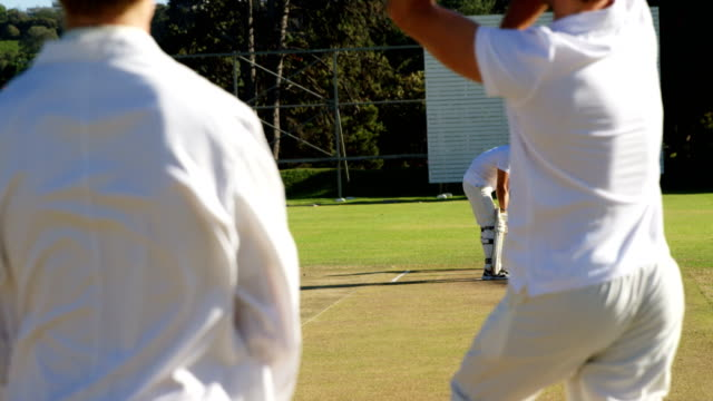 Bowler delivering ball during cricket match video