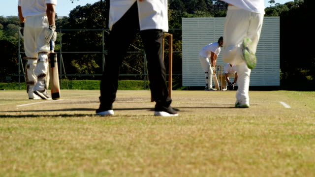 Bowler delivering ball during cricket match Bowler delivering ball during match on cricket field 20 29 years stock videos & royalty-free footage