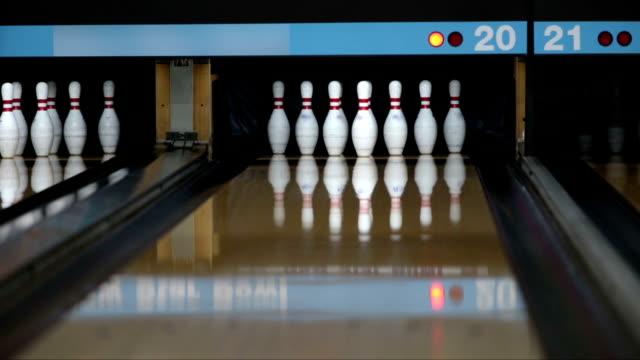 Bowler playing bowling and make a strike