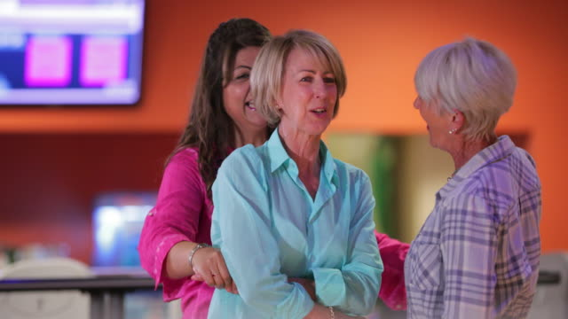 Bowling Joy A front facing shot of a small group of senior women celebrating in a bowling alley. hobbies stock videos & royalty-free footage
