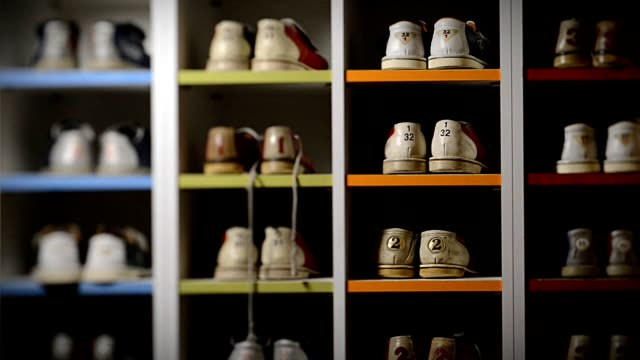 Bowling shoes, on pair is taken out of the rack video