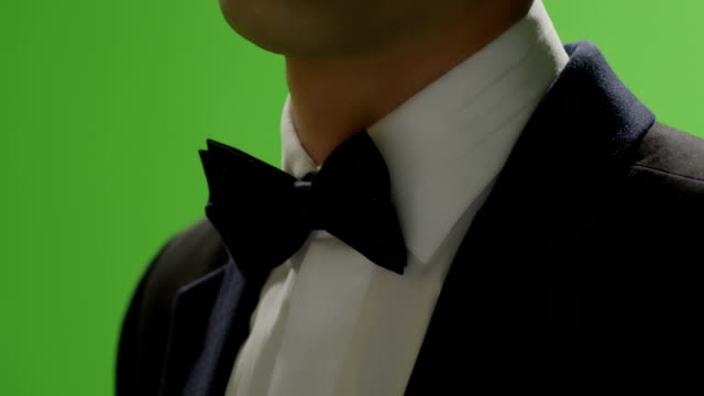 Bowtie Adjustment. Man wears shiny cufflink. Green screen. FEW SHOTS! Shot on RED EPIC Cinema Camera. video