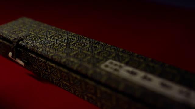 vídeos de stock e filmes b-roll de box and painbrush for a calligraphy  close-up macro - japanese font