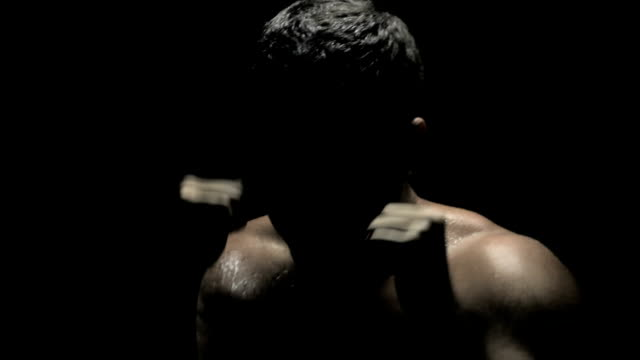 Boxer in Shadows - Shadow Boxing in Dark Sweating Punching Punches video