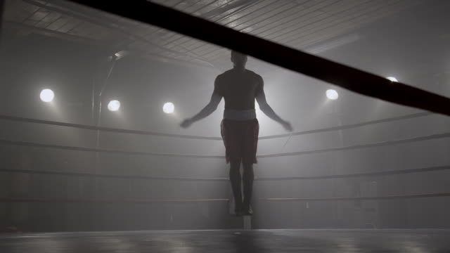 Boxer jumping rope in boxing ring video