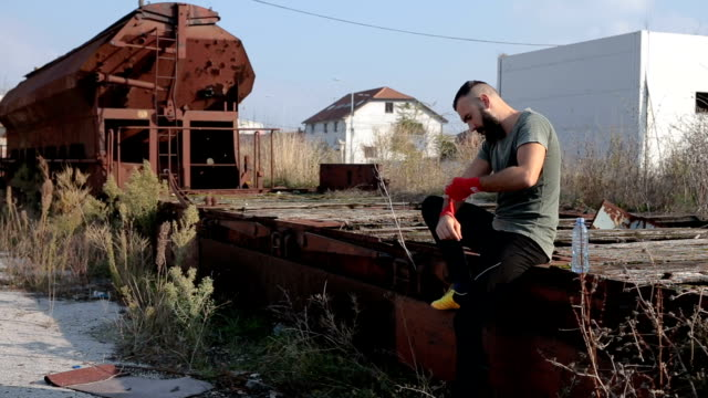 Boxer on an abandoned train station wrapping hands video