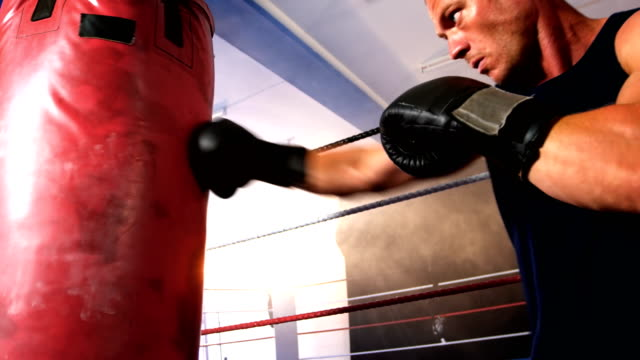 Boxer practicing boxing with punching bag video