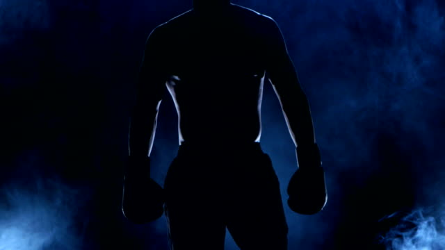 Boxer shows that he is ready to fight. Dark background video