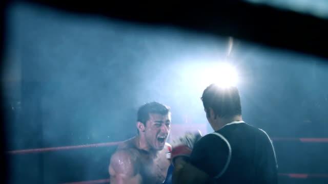 boxer training with his coach - campionato video stock e b–roll